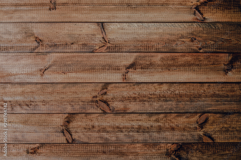 Dark wooden boards as a background. A background made of horizontally arranged boards. Nice boards for printing.