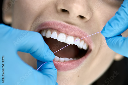 Carta da parati Pretty woman's teeth cleaning in dental clinic