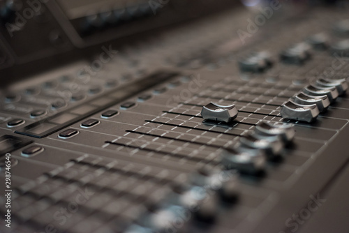 Audio sound mixer console. Audio mixer, music equipment. broadcasting tools, mixer, synthesizer. and computer control.Professional sound and audio mixer control panel with buttons and sliders. - 298746540