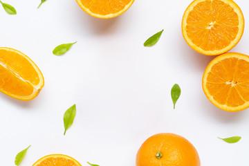 Frame made of fresh orange citrus fruit with leaves isolated on white background.