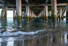 View On Sea Or Ocean Water Onder Old Wooden Pier Or Bridge