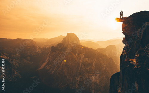 Couple on Cliff Sunrise in Yosemite - 298752534