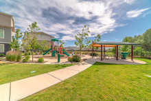 Park At A Sunny Neighborhood With Childrens Playground And Pavilion Eating Area