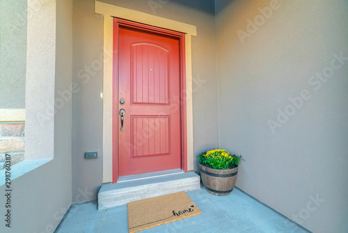 Red wooden front door at the entrance of a home with concrete exterior wall Canvas-taulu