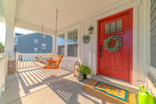 Front Porch Of Modern Home With Swinging Chair