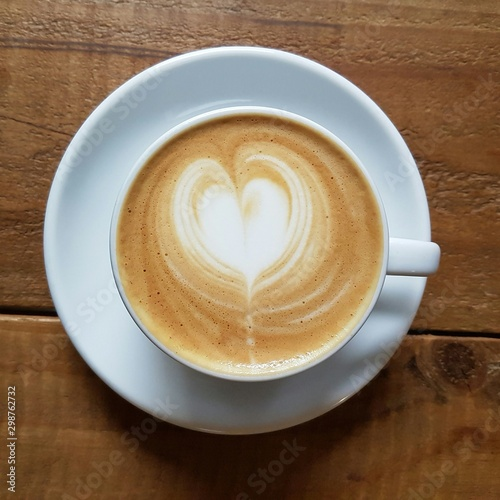 Wall Murals Cafe milk coffee with a heart shape from milk in a cup