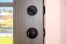 Close Up Of Black Door Knob And Unlocked Latch