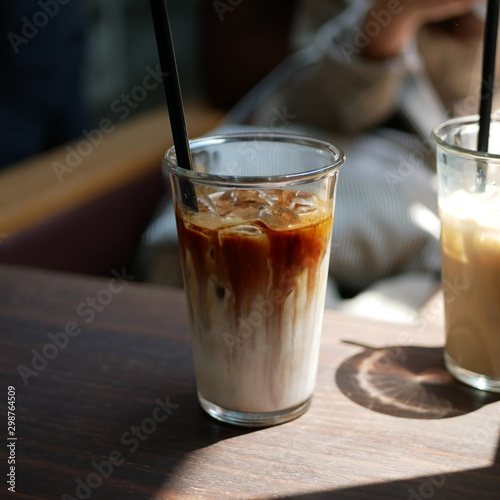 milk coffee with caramel on it in the glass