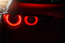 Close Up Car Tail Light Red Color On Service Blurry Background.Using Wallpaper Background For Automobile Transport And Automotive Image.