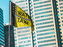 Yellow Flag Of Water Taxi In New York City USA With Business Building In Vintage Style