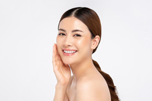 Asian Woman Smiling With Hand Touching Face For Beauty And Skin Care Concepts
