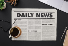 Business Newspaper And Office Supplies With Notebook, Hot Coffee Cup, Glasses, Books, Newspaper And Accessories On Black Desk Topview With Copy Space, Daily Newspaper Mockup Concept