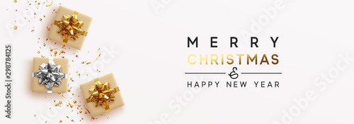 Obraz Banner Merry Christmas and Happy New Year. Realistic brown and white gift boxes, Shiny golden confetti. Festive background Greeting card, poster. Xmas present. flat lay, top view. Vector illustration - fototapety do salonu