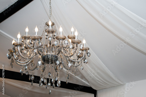 Fotomural Chrystal chandelier lamp on the ceiling in a wedding tent