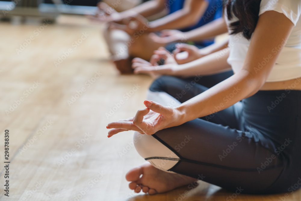 Fototapety, obrazy: Close up woman hands practices yoga and meditation in the lotus pose at fitness club.Healthy and Relax Concept