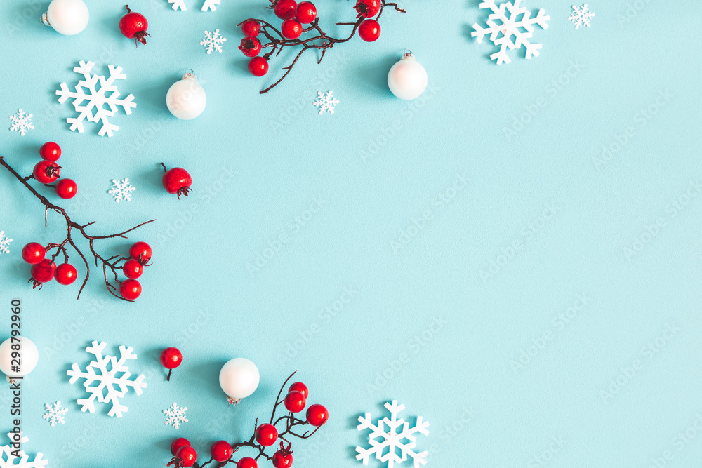 Fototapety, obrazy: Christmas or winter composition. Snowflakes and red berries on blue background. Christmas, winter, new year concept. Flat lay, top view, copy space