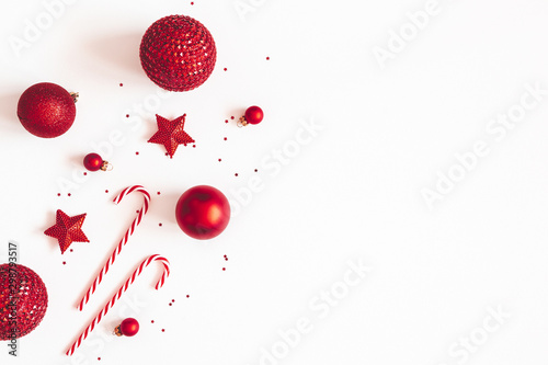 Christmas composition. Red decorations on white background. Christmas, winter, new year concept. Flat lay, top view, copy space - 298793517