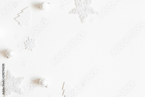 Autocollant pour porte Fleur Christmas composition. Frame made of white decorations on white background. Christmas, winter, new year concept. Flat lay, top view, copy space