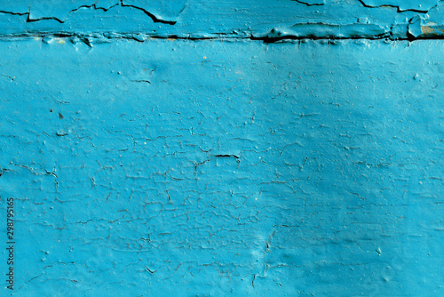 Pinturas sobre lienzo  Blue color old painted wooden wall lit by sun close-up