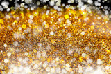Fototapeta Kawa jest smaczna - Glitter lights gold or yellow grunge background. Glitter defocused abstract Twinkly Lights and Stars Christmas Background