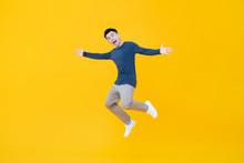 Asian Man Smiling And Jumping ...
