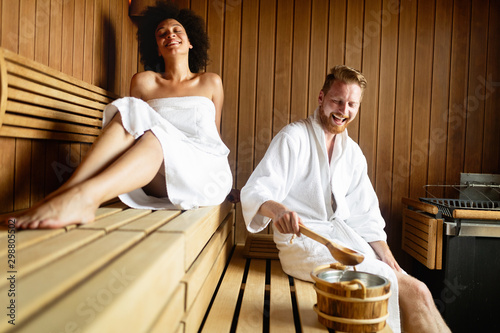 Foto auf AluDibond Logo Couple relaxing, resting and sweating in sauna