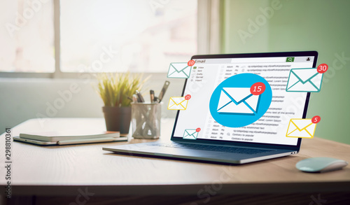 Obraz New email alert on laptop, communication connection message to global letters in the workplace. - fototapety do salonu