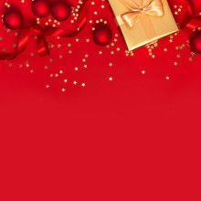 Flat Lay Xmas Holiday 2020 Celebration. New Year Christmas Golden Presents With Ribbon, Christmas Balls, Gold Confetti Stars On Red Background Top View. Gift Boxes Greeting Card Festive Decorations