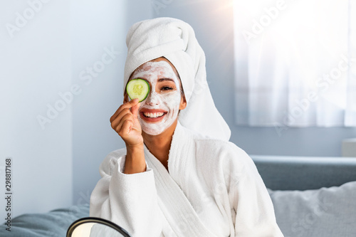 Cuadros en Lienzo  Young woman with cleansing mask on her face at home