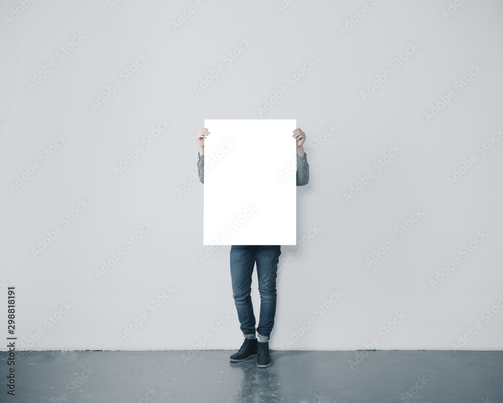 Fototapeta Man holding blank poster