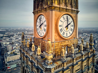 Panel Szklany PodświetlaneBeautiful panoramic aerial close-up drone view to the Millennium clock (clock face diameter = 6.5 m) on the tower of PKiN and cityscape of Warsaw modern City, Poland