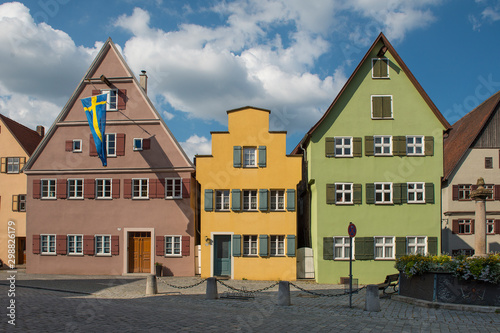 Fototapety, obrazy: Dinkelsbühl, Bavaria, Germany - July 15, 2019; Colorful houses in a street in Dinkelsbühl an touristic town on the romantic road