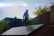 canvas print picture - Technician installs solar panels on the roof