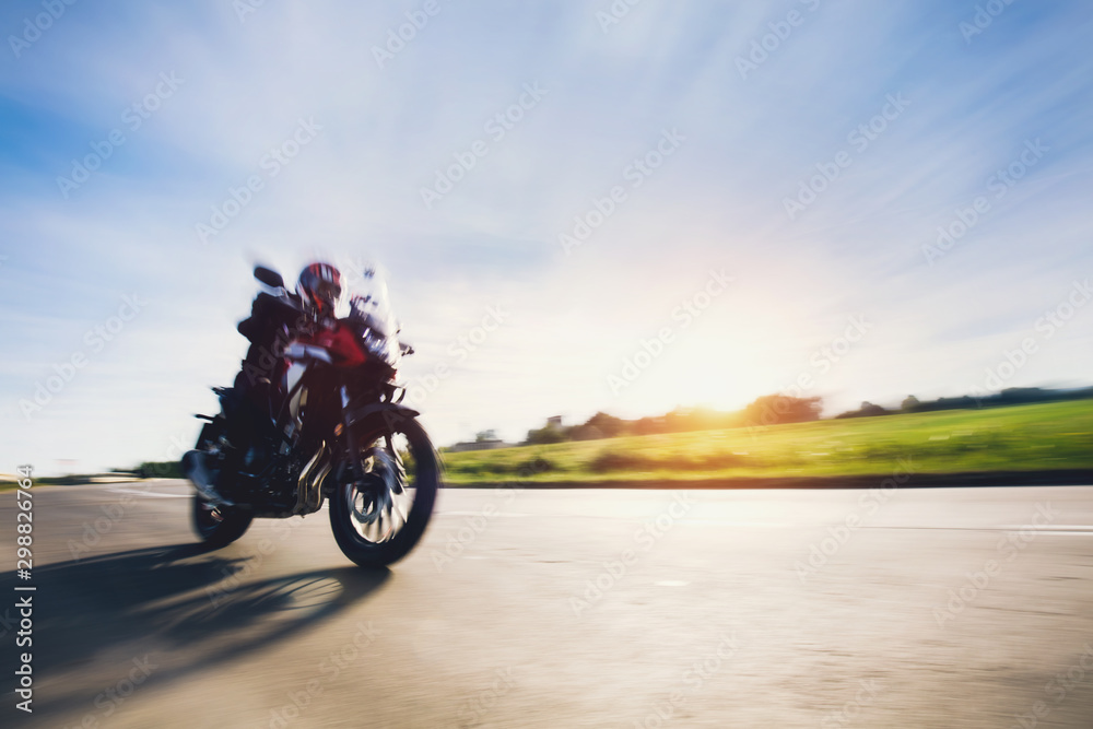 Fototapety, obrazy: Drive a motorbike. Fast motorcycle in motion on asphalt road.