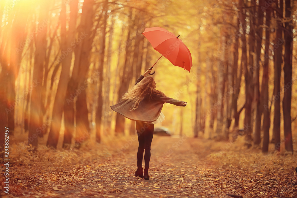Fototapety, obrazy: young woman dancing in an autumn park with an umbrella, spinning and holding an umbrella, autumn walk in a yellow October park