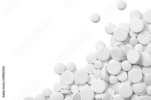 Heap of pills on white Fototapeta