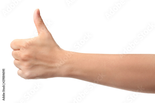 Hand of woman showing thumb-up gesture on white background Canvas Print