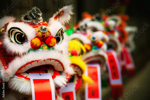 Traditional colorful chinese lion, Chinese paper means: good fortune. - 298847106
