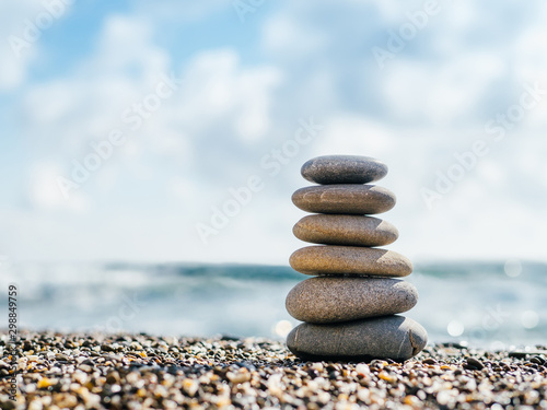 Poster Spa Stones balance on beach with copy space for text or design. Stones pyramid as zen, harmony, balance concept