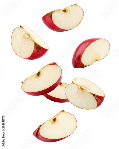Cuadros en Lienzo Falling Red apple slice isolated on white background, clipping path, full depth