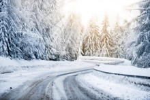 Winter Beautiful Snowy Road Snow Or Landscape Forest And Trees Covered With Snow. Yellow Sun Shine Lights In Background.