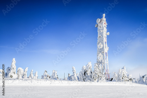 Frozen television or cellular tower in heavy snow near ski center Canvas Print