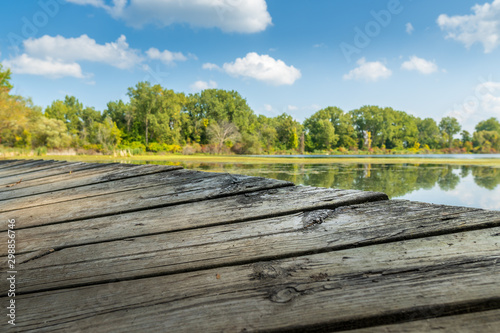 Fotografie, Tablou Edge of an old dock at a lake in Saginaw, Michigan