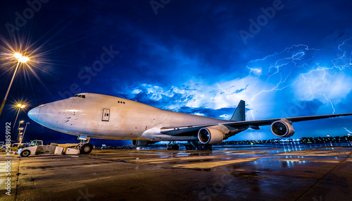 jumbo aircraft in thunderstorm/rian/bad weather Canvas Print