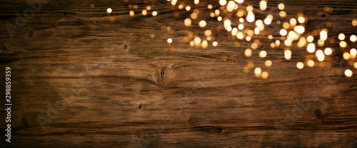 Christmas lights on old wood - 298859359