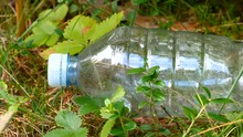 Closer Look Of The White Cap Of The Plastic Bottle