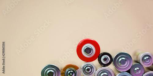 Fotografía  Many different types used or new battery, rechargeable accumulator, alkaline batteries on color background