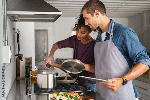 Foto Woman adding salt in pot while cooking