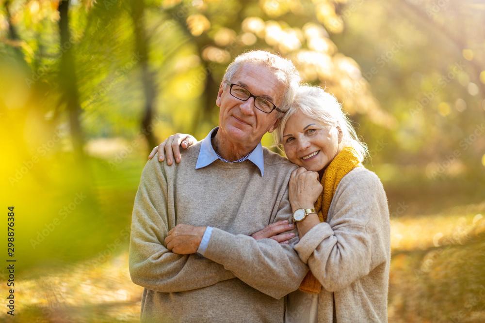 Fototapeta Happy senior couple in autumn park