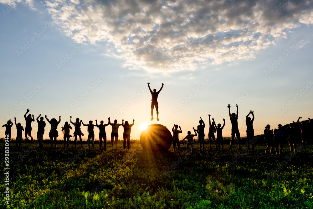 Fototapety, obrazy: Many children jumping at the same time in the sunset